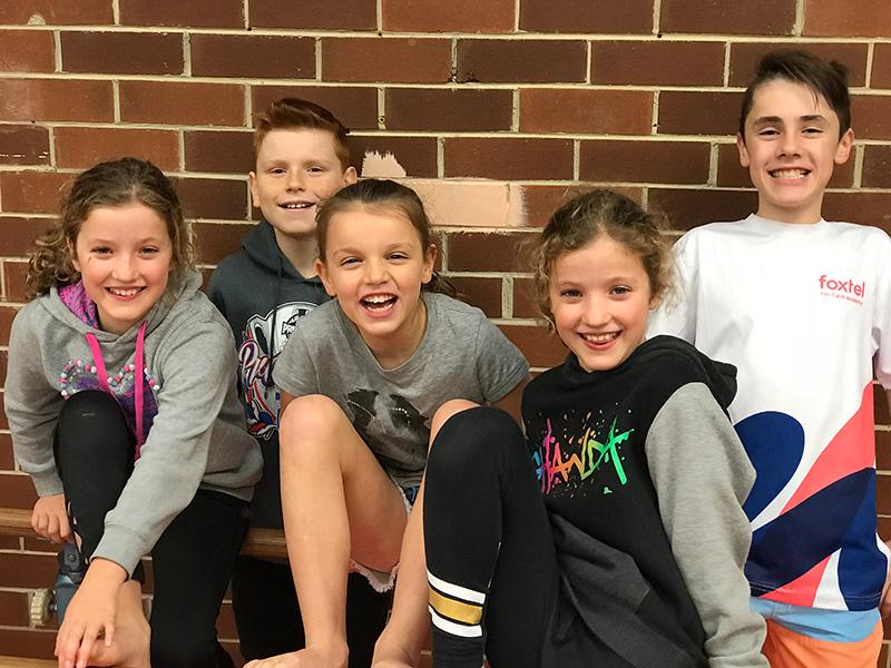 Five happy kids taking part in Fitnessworx Trilogy school holiday programs