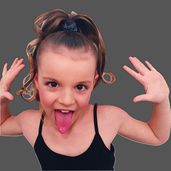 Girl with hands up and poking her tongue out during dance and movement school holiday programs